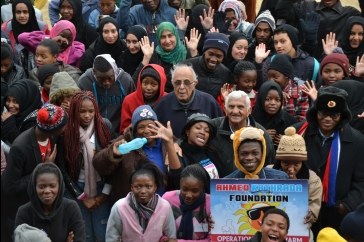 Anti-apartheid struggle veterans, Ahmed Kathrada and Laloo Chiba, participate in Operation Winter Warm with the Foundation's youth.